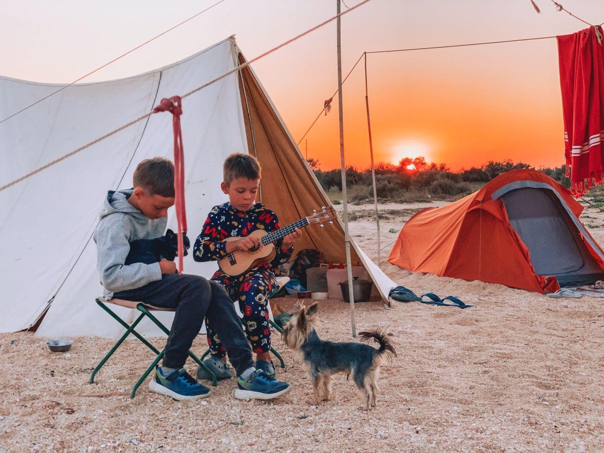 kids enjoying camp and playing guitar
